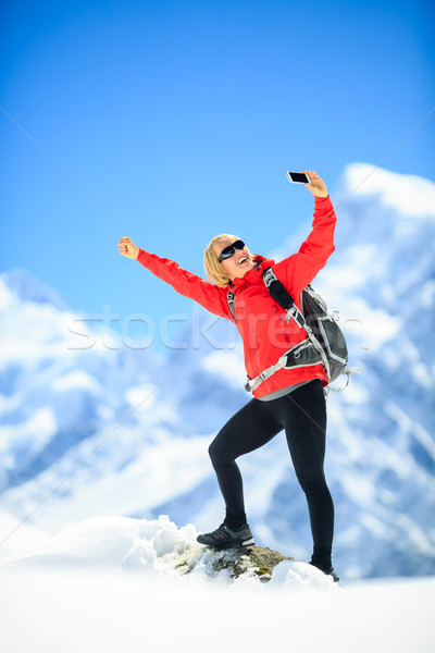 Woman success selfie with smartphone Stock photo © blasbike