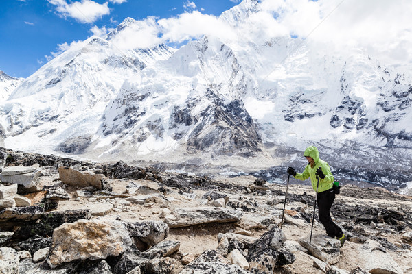Woman hiking with Everest in background Stock photo © blasbike