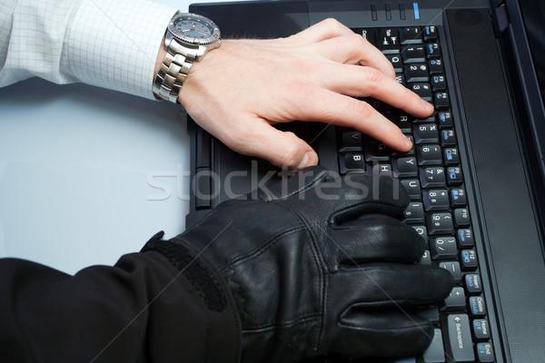 Személyazonosság-lopás hacker üzletember egy személy dolgozik laptop számítógép Stock fotó © blasbike