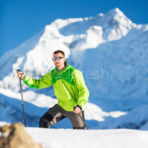 Man climbing exploring winter mountains Stock photo © blasbike