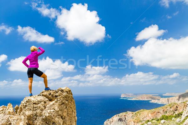 Stock photo: Woman climber or runner winner reaching life goal success on top