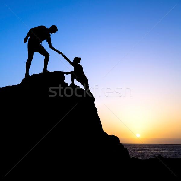 Uomo donna help silhouette montagna Coppia Foto d'archivio © blasbike