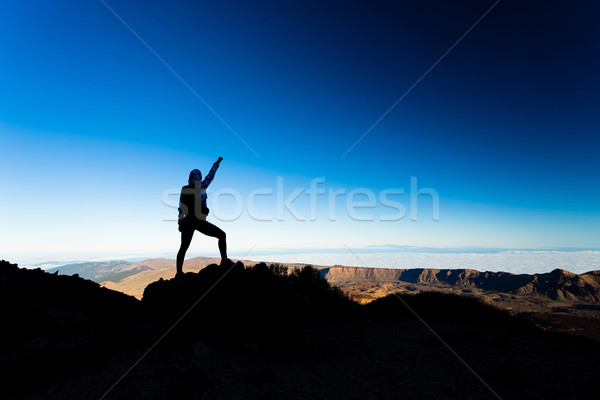 Woman hiking success silhouette on mountain top Stock photo © blasbike