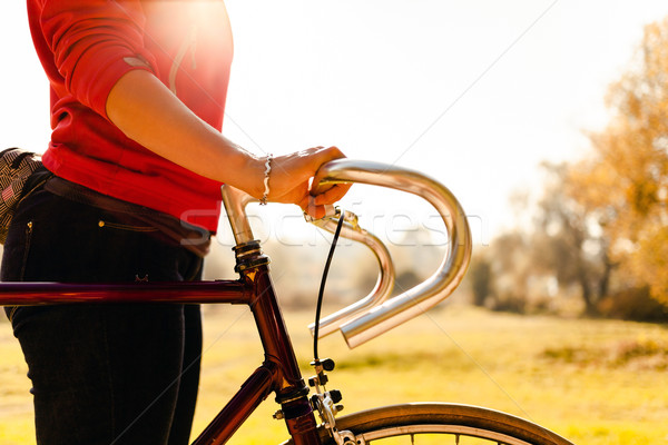 Woman cycling on bicycle in autumn park Stock photo © blasbike