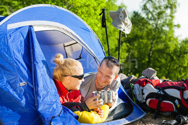 Couple backpackers camping in tent Stock photo © blasbike
