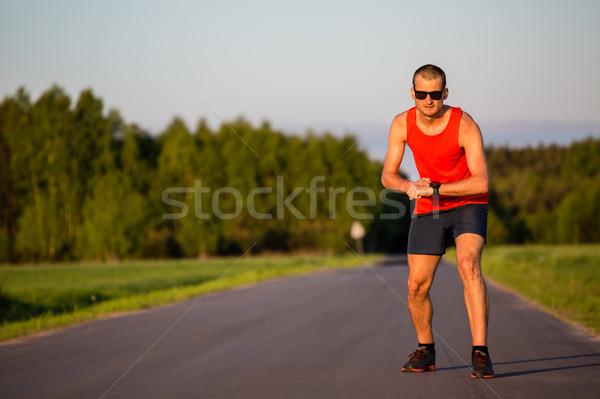 Man running on country road training Stock photo © blasbike