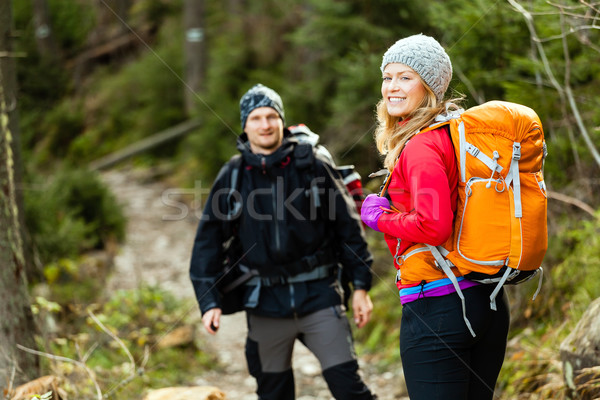 Couple happy hikers walking in mountains Stock photo © blasbike