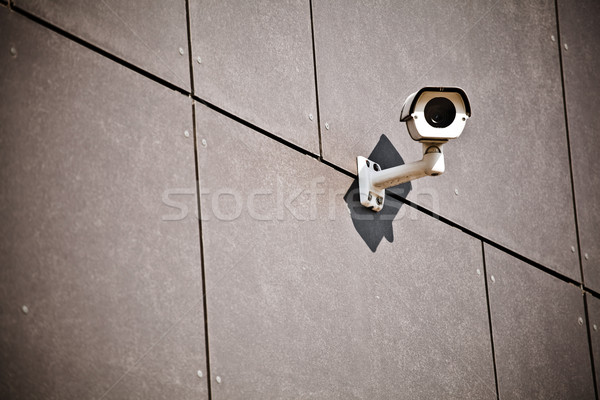 Security camera on office building wall Stock photo © blasbike