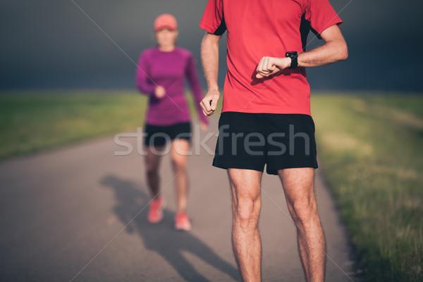 Couple running on country road Stock photo © blasbike