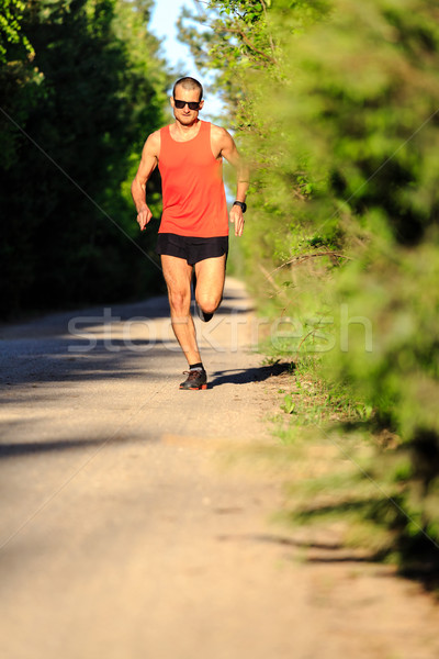 Man running on country road and training Stock photo © blasbike