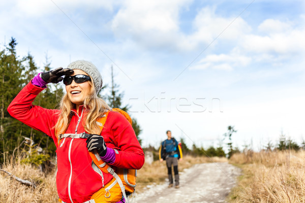 Couple hiking on trail in autumn forest Stock photo © blasbike