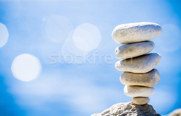 Stones balance, pebbles stack over blue sea in Croatia. Stock photo © blasbike