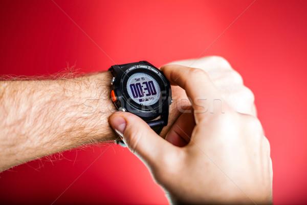 Runner checking sport watch XXXL Stock photo © blasbike