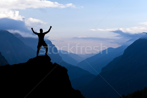 Man hiking success silhouette in mountains Stock photo © blasbike