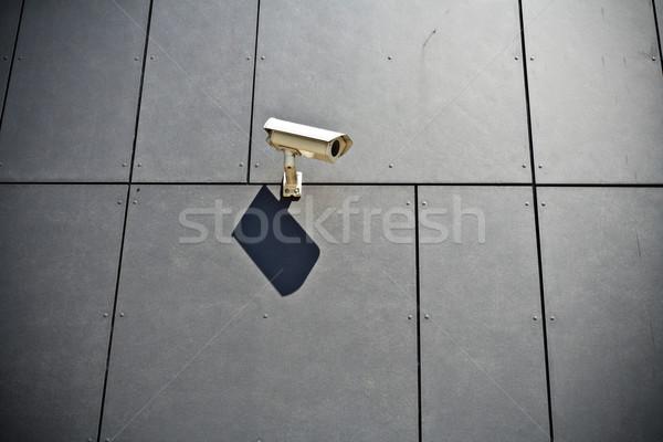 Biztonsági kamera szürke modern épület fal technológia város Stock fotó © blasbike