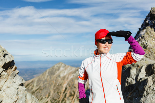 Happy woman hiking in sunny mountains Stock photo © blasbike