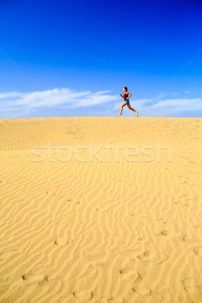 Young woman running on sand desert dunes Stock photo © blasbike