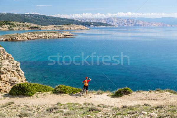 Mountain biker riding on bike on rocky trail Stock photo © blasbike
