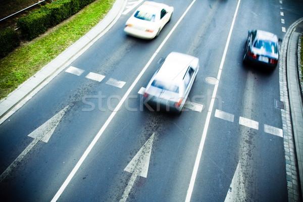 Traffic motion blur on busy street Stock photo © blasbike