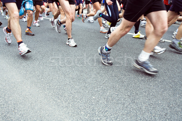 Stock photo: People running in city marathon on street, motion blur