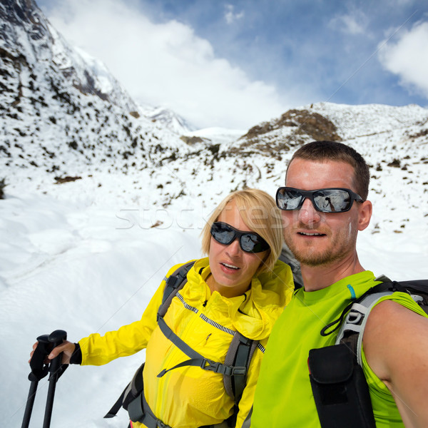 Couple hikers selfie portrait expedition in winter mountains Stock photo © blasbike