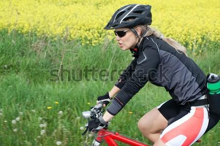 Woman riding a bike, motion blur Stock photo © blasbike