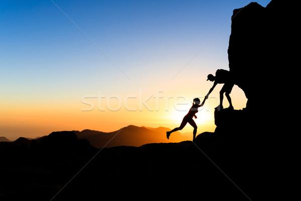 Takım çalışması çift tırmanma el helping güven yardım Stok fotoğraf © blasbike