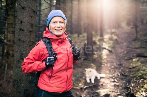 Boldog nő kirándulás sétál kutya erdő Stock fotó © blasbike