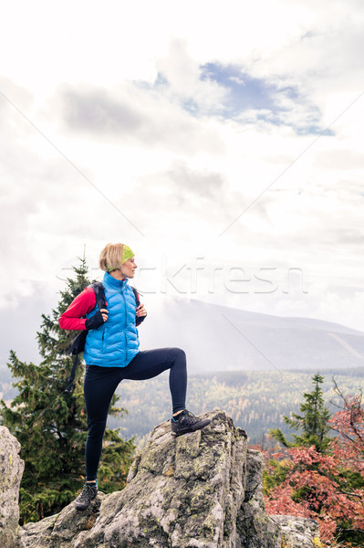 Woman hiking in autumn mountains and woods Stock photo © blasbike