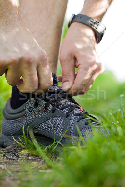Trail runner tying shoe Stock photo © blasbike