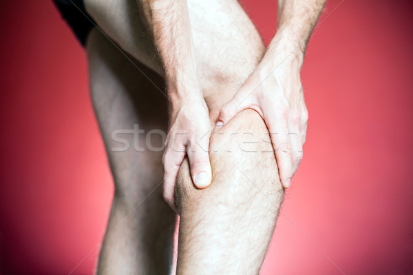 Genou douleur jambe massage homme Photo stock © blasbike