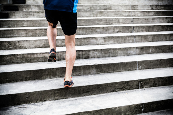 Man running on stairs, sports training Stock photo © blasbike