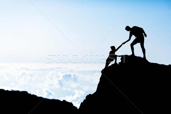Adam kadın yardım siluet dağlar çift Stok fotoğraf © blasbike