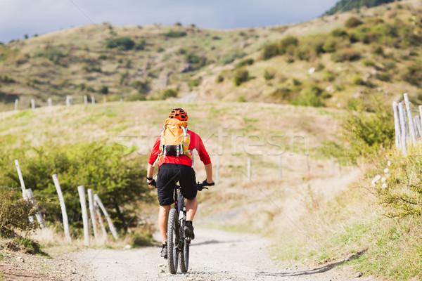 Man enduro mountain biking on country road Stock photo © blasbike