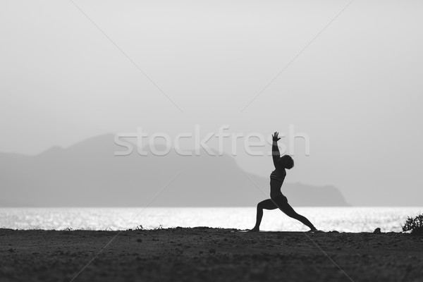 Woman meditating in yoga pose silhouette Stock photo © blasbike