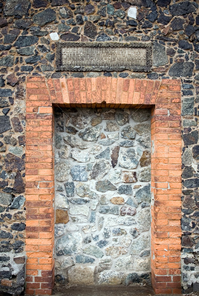 Stone wall with doors of medieval church Stock photo © blasbike