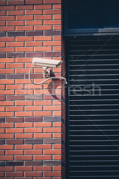 Security camera, surveillance safety system on office building Stock photo © blasbike