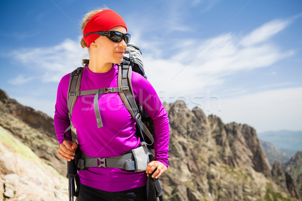 Woman hiking with backpack in inspirational mountains Stock photo © blasbike