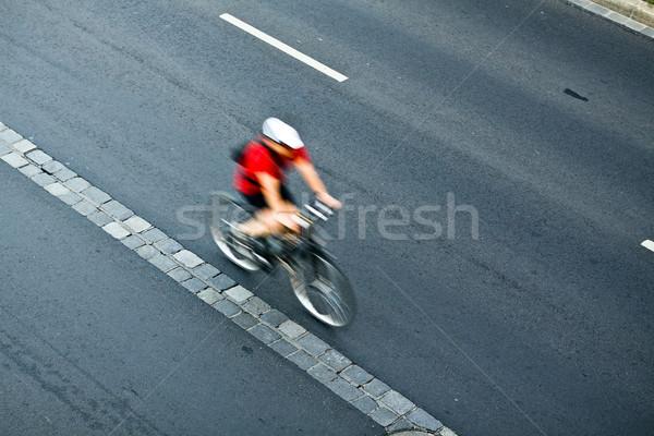 Man cycling on city street, motion blur Stock photo © blasbike