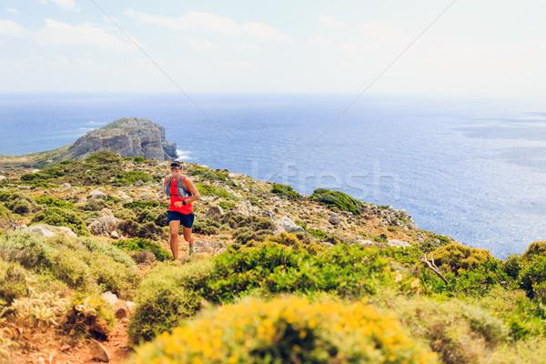 Happy trail running man in beautiful mountains Stock photo © blasbike
