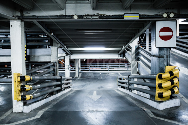 Parking garage in basement, underground interior, stop sign entr Stock photo © blasbike