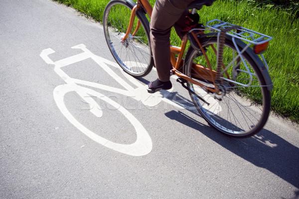 Nő biciklizik munka elmosódott kerékpáros lovaglás Stock fotó © blasbike