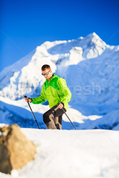 Man hiker or climber accomplish in winter mountains Stock photo © blasbike