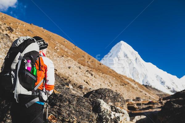Woman hiking with backpack in Himalaya Mountains. Trekking to Ev Stock photo © blasbike