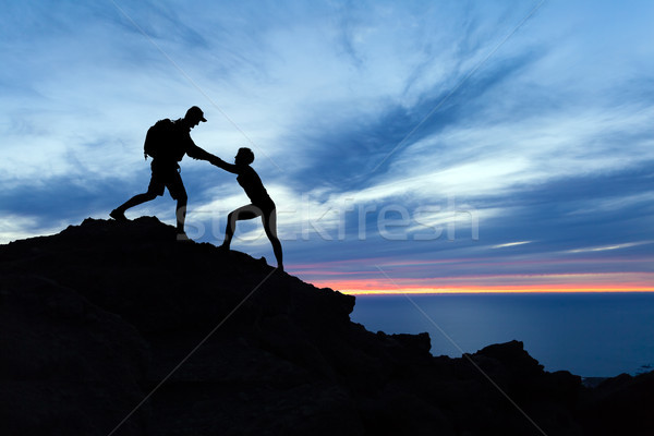 Stock photo: Teamwork couple hikers silhouette in mountains, climbers team