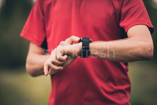 Runner opleiding stopwatch hartslag monitor lopen Stockfoto © blasbike