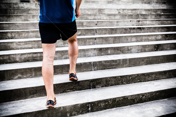 Man running on stairs, jogger Stock photo © blasbike