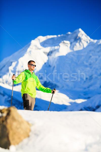 Man hiker or climber accomplish in winter mountains Stock photo © blasbike