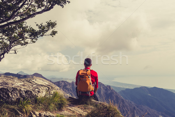 Hiking man or trail runner looking at mountains Stock photo © blasbike