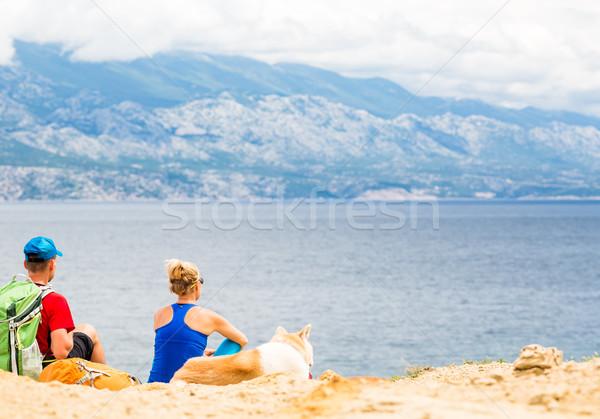 Casal caminhada cão beira-mar montanhas Foto stock © blasbike